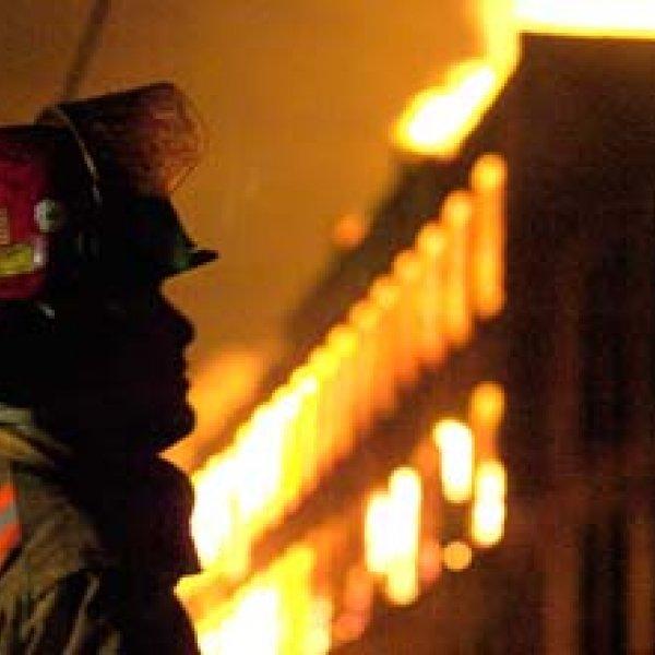 fireman watching a structure fire